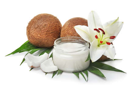 Beautiful composition with coconut oil and nuts on white background