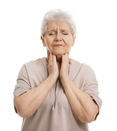 Elderly woman suffering from sore throat on white background Фото со стока