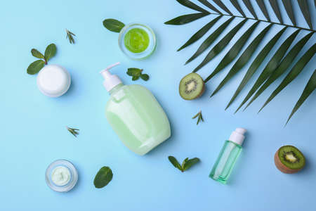 Flat lay composition with body care products on color background