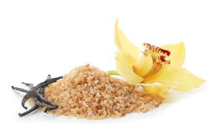 Vanilla sugar, sticks and flower on white background