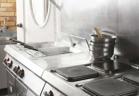 Professional equipment with cookware in restaurant kitchen 写真素材