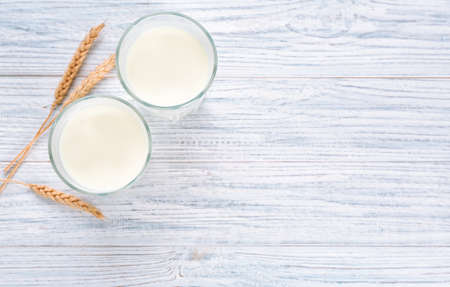 Glasses of milk on wooden table. Fresh dairy product Stock Photo