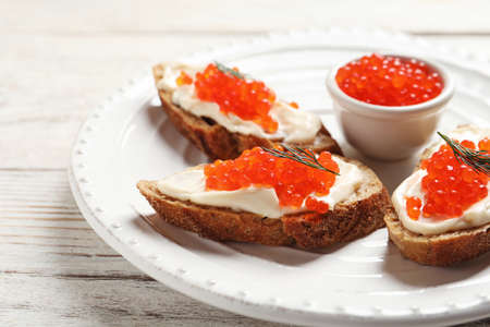 Sandwiches with red caviar on plate