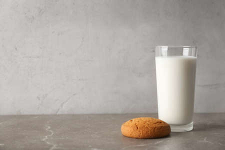 Glass of milk with oatmeal cookie on table. Fresh dairy product Stock Photo