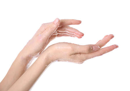Young woman applying natural scrub on hands against white background