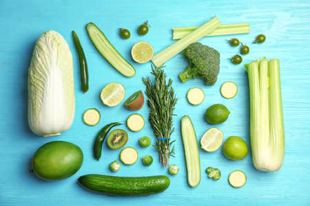 Flat lay composition with green vegetables and fruits on wooden background. Food photography
