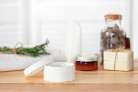 Jar with cream on wooden table. Body care cosmetics