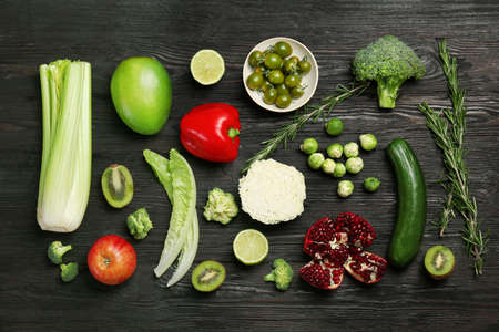 Flat lay composition with vegetables and fruits on wooden background. Food photography Stock Photo