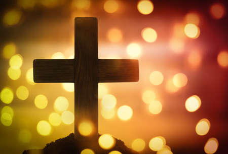 Wooden cross on blurred background. Christian religion