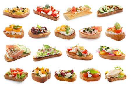 Set with different delicious bruschettas on white background