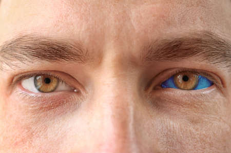 Mature man with eyeball tattoo, closeup