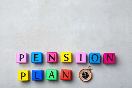 Colorful cubes with text PENSION PLAN and compass on light background Imagens