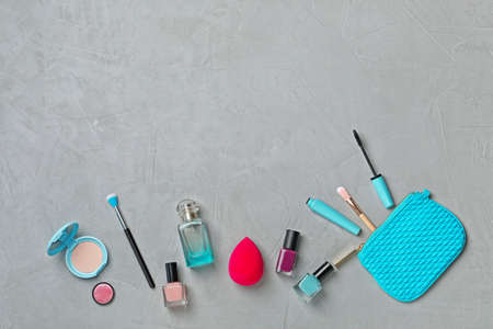 Flat lay composition with cosmetic products on grey background