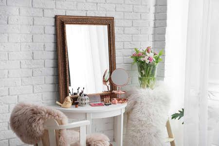 Beautiful mirror on table in modern makeup room