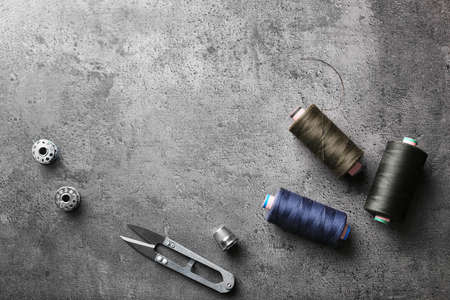 Composition with accessories for tailoring on grey background