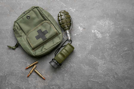 Set of military outfit on grey background