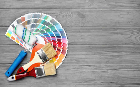 Set of decorator's tools on wooden background, flat lay