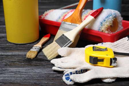 Set of decorators tools on wooden background, closeup