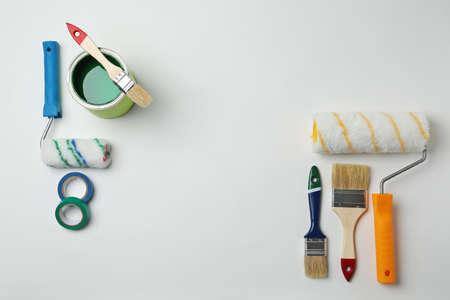 Set of decorator's tools on light background, flat lay