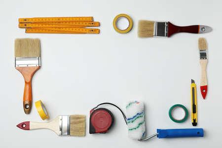 Set of decorator's tools on light background, flat lay Archivio Fotografico - 105139478