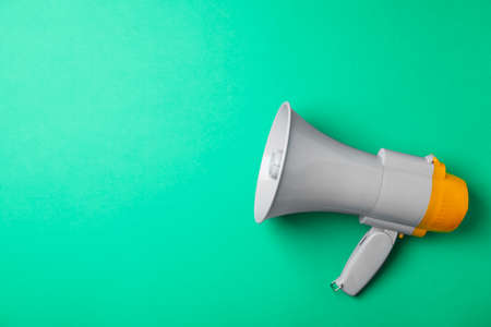 Electronic megaphone on color background Stock Photo