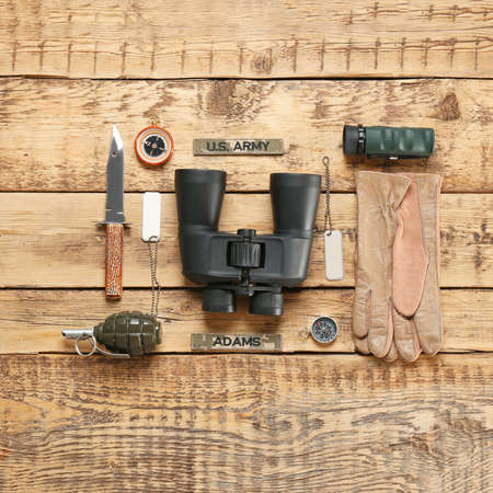Set of military equipment on wooden background, flat lay