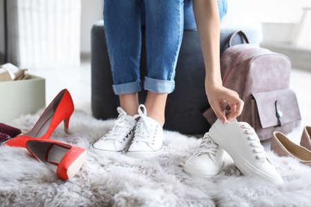 Young woman trying on shoes in store Stock Photo