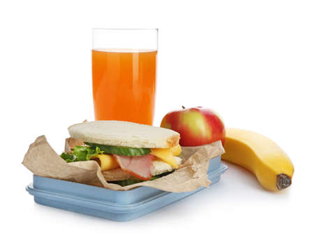 Lunch box with appetizing food and glass of juice on white background 写真素材