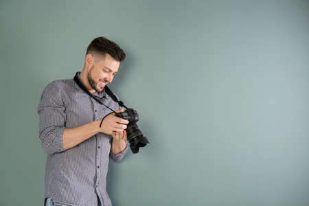Male photographer with camera on grey background 写真素材