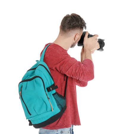 Fotógrafo masculino con cámara sobre fondo blanco. Foto de archivo