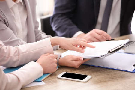 Young consultant working with clients in office