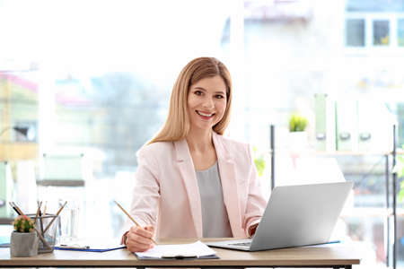 Consultant working at table in office