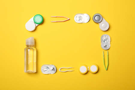 Flat lay composition with contact lenses and accessories on color background
