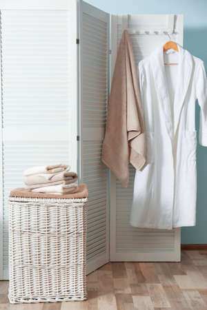 Bathroom interior with laundry basket and soft towels Stock Photo