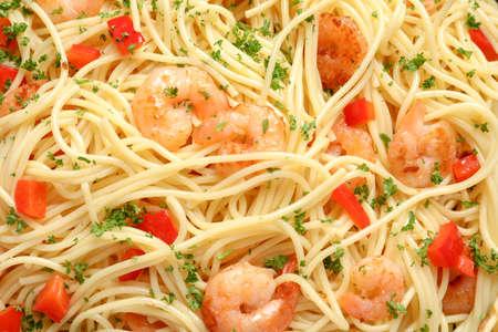 Delicious spaghetti with shrimps, closeup