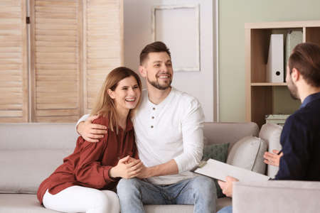 Family psychologist working with young couple in office