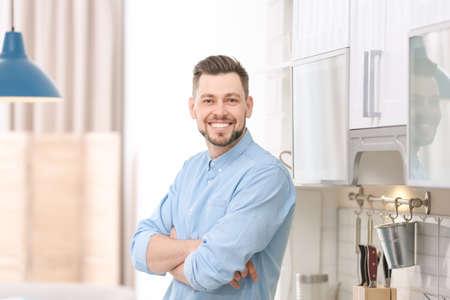 Portrait of handsome young man in kitchen Reklamní fotografie