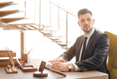 Male lawyer working in office Stock Photo