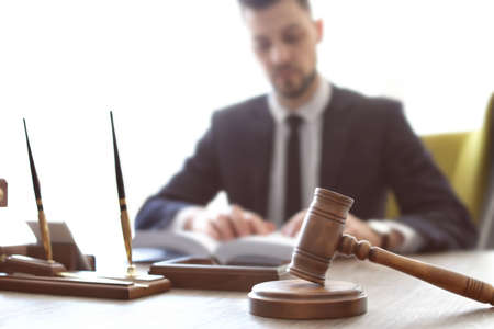 Gavel on table and lawyer in office