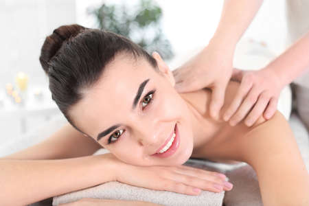 Young woman receiving massage in spa salon