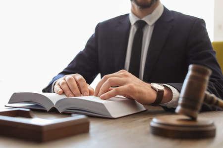 Male lawyer working in office Фото со стока