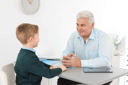 Little boy having appointment at child psychologist office