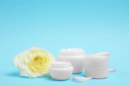 Composition with cosmetic products on color background Stock Photo