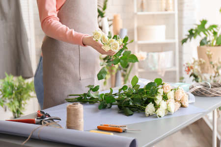 Female florist creating bouquet at workplace