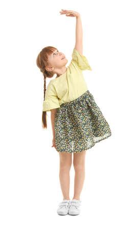 Little girl measuring her height on white background Stock Photo