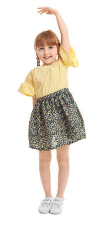 Little girl measuring her height on white background Foto de archivo - 105471951