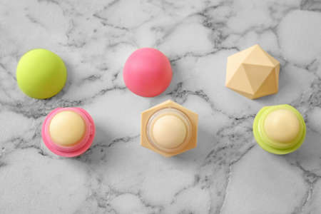 Hygienic lip balms on light background