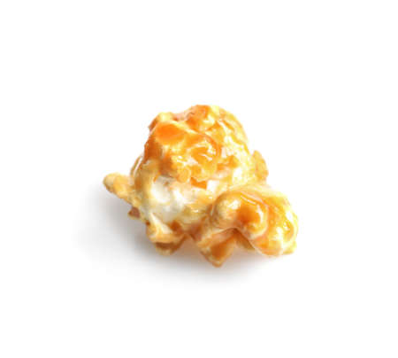 Delicious popcorn with caramel on white background