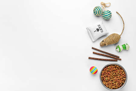 Flat lay composition with cat accessories and food on white background