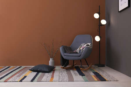 Modern living room interior with comfortable rocking chair and beautiful carpet Stock Photo